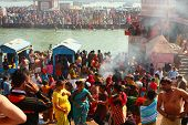 HARIDWAR, INDIA - JANUARY 14: Puja ceremony on the banks of Ganga, people celebrate Makar Sankranti, Jan 14, 2009 in Haridwar, India. Makar Sankranti huge Religious festival regarding Sun and Harvest.