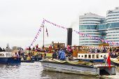 AMSTERDAM, THE NETHERLANDS - NOVEMBER, 18, 2012 - The people on the boats greet Sinterklaas