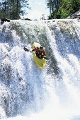 Man Canoeing Down Fast Waters