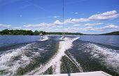 image of long distance relationship  - 2 people water skiing - JPG