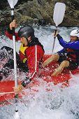 Men Rafting In Fast Waters