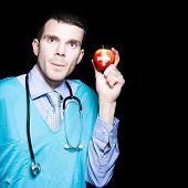 Healthy Eating Metaphor With Doctor Holding Apple