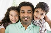Middle Eastern Father With Children At Home