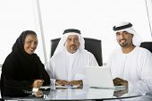 Middle Eastern Business Men / Woman At Desk With Laptop