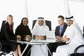 Middle Eastern And Western Men / Women In Business Meeting