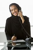 Middle Eastern Business Woman On Phone At Desk