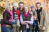 stock photo of 6 year old  - Family outdoors at park smiling  - JPG
