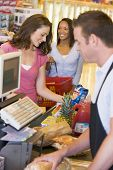 picture of hair integrations  - Women paying for purchases at a grocery store - JPG