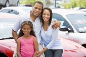 Family Sat On Car
