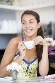 Woman Eating Cake In Tea Room