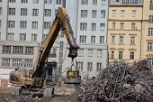 stock photo of junk-yard  - Magnet separate steel at demolition of concrete building - JPG