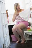 Comical Image Of Woman In Bathroom With Over-Sized Knickers