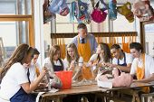 stock photo of cornrow  - Students receiving art lessons - JPG