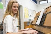 Teen Pupil Practising The Piano In Classroom