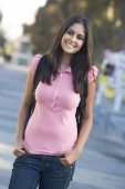 Women Standing Outdoors Smiling (Selective Focus)