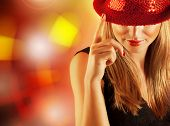 Photo of gorgeous dancer female with finger up on the stage in disco club, closeup portrait of prett