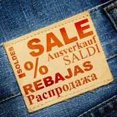 Label with word SALE in different languages