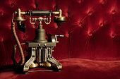 Vintage Telephone - Retro Phone on Classic Red Velvet Couch