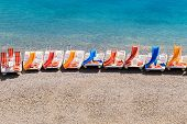 Colorful Pedal Boats On A Beach