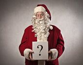 Santa Claus holding a question mark