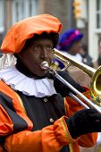 Zwarte Piet Playing Trombone. He Is A Helper Of Dutch Saint Nicolaas