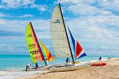 VARADERO,CUBA-NOVEMBER 3:Foreign tourists sailing on a catamaran November 3,2012 in Varadero.The cuban revenues associated to the tourism industry have increased in a 7.7% this year compared to 2011