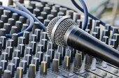 stock photo of mixer  - Microphone lying on the mixing desk  - JPG