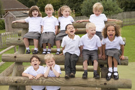 stock photo of school child  - Students outdoors on wooden structure shouting - JPG