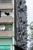 Satellite Dishes On The Facade Of A Tower Block