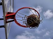 The ball flies into the basketball hoop