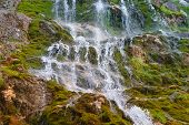 Waterfall In Rocky Mountains Caucasus