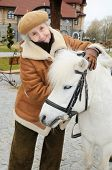 Elderly Woman Near Pony