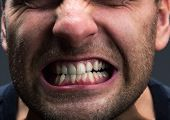 picture of growl  - Closeup of mouth of very stressed man - JPG