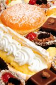 Many cakes,eclair and donut