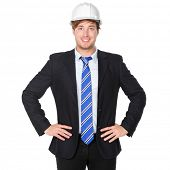Engineer or architect business man in suit. Male businessman wearing white hard hat helmet smiling h