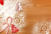 Christmas background with Candies, snowflakes and decorative Christmas Tree on wooden table with cop