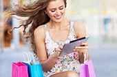 picture of mall  - Shopping woman using digital tablet - JPG