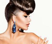 Fashion Model Girl Portrait with Blue Earrings. Creative Hairstyle. Hairdo. Make up. Beauty Woman is
