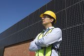 Confident maintenance worker near solar panels