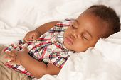 Closeup of 6 Month Old Little Baby African American Boy Sleeping in Cradle