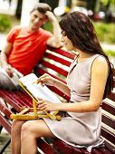 Couple portray on bench at park  . Outdoor.