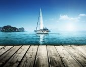 stock photo of sailing vessel  - yacht and wooden platform - JPG