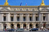 PARIS, FRANCE- MAY 18: Main facade of the Opera Garnier or Palais Garnier on May 18, 2013 in Paris, France. This famous opera house, inaugurated in 1875, has 1,979 seats