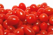 Grape Tomatoes Closeup Isolated On The White.