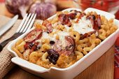 Italian style baked pasta with bacon, sausage and melted cheese