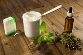 White tablets and green leaves of natural sweetener stevia