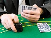 picture of playing card  - hands of men who makes a bet at the casino - JPG