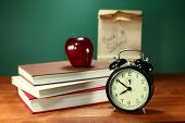 Clock Apple and Stack of Books on A Desk for Back to School
