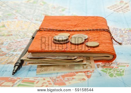 Close-up Travel Arrangement of Euro money, Map and notepad diary poster