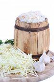 Marinated cabbage (sauerkraut), in wooden barrel, isolated on white